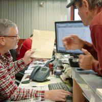 img_mc-lowell-guys-at-desk-2